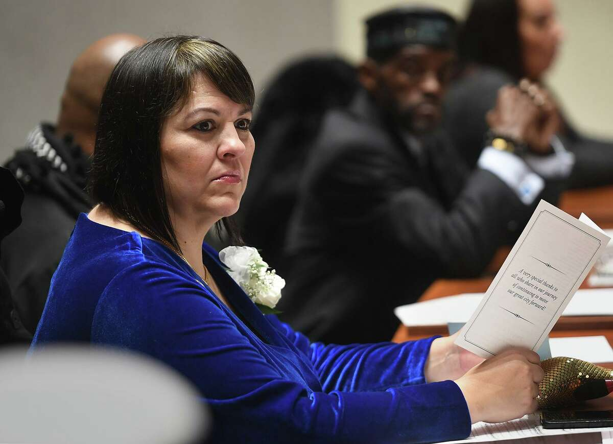 Newly elected City Councilwoman Maria Pereira, left, and City Councilman Ernest Newton, during the swearing in ceremony of city officials at City Hall in Bridgeport, Conn. on Thursday, November 28, 2019.