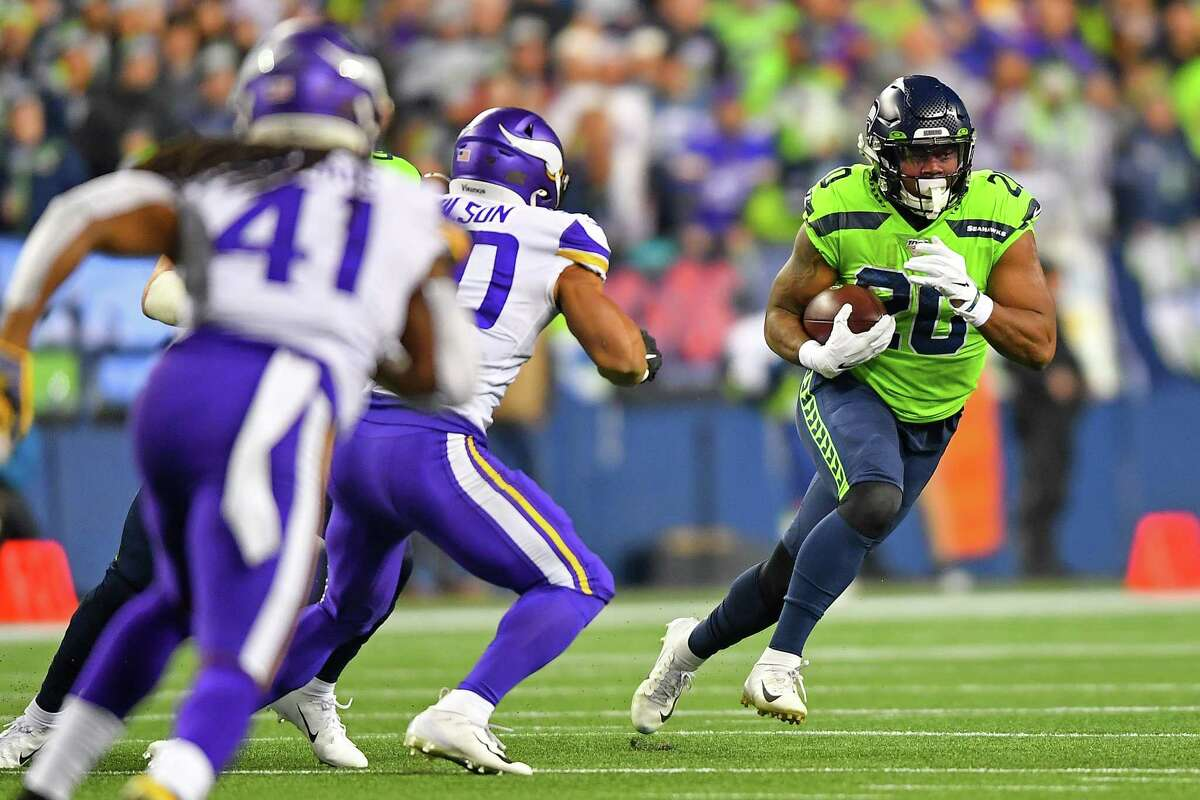 SEATTLE, WASHINGTON - DECEMBER 02: Rashaad Penny #20 of the Seattle Seahawks runs the ball during the first quarter against the Minnesota Vikings at CenturyLink Field on December 02, 2019 in Seattle, Washington. (Photo by Alika Jenner/Getty Images)
