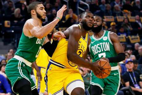 Golden State Warriors forward Eric Paschall (7) drives to the hoop and scores against Boston Celtics forward Jayson Tatum (0) and guard Jaylen Brown (7) in an NBA game at Chase Center on Friday, Nov. 15, 2019, in San Francisco, Calif. The Boston Celtics won 105-100.