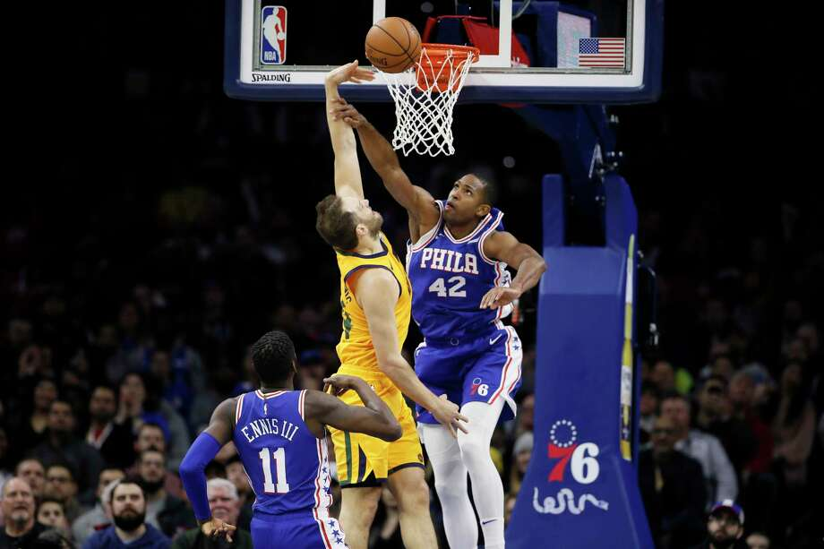 Philadelphia 76ers' Al Horford, right, blocks a shot by Utah Jazz's Bojan Bogdanovic, center, as 76ers' James Ennis III looks on during the first half of an NBA basketball game, Monday, Dec. 2, 2019, in Philadelphia. (AP Photo/Matt Slocum) Photo: Matt Slocum / Copyright 2019 The Associated Press. All rights reserved