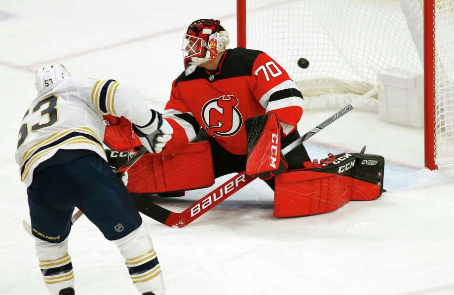 Buffalo Sabres forward Jeff Skinner (53) puts the puck past New Jersey Devils goalie Louis Domingue (70) during the first period of an NHL hockey game Monday, Dec. 2, 2019, in Buffalo, N.Y. (AP Photo/Jeffrey T. Barnes) Photo: Jeffrey T. Barnes / Copyright 2019 The Associated Press. All Rights Reserved.