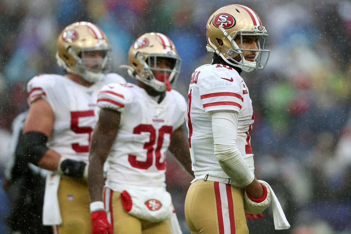 BALTIMORE, MARYLAND - DECEMBER 01: Quarterback Jimmy Garoppolo #10 of the San Francisco 49ers looks on against the Baltimore Ravens in the first half at M&T Bank Stadium on December 01, 2019 in Baltimore, Maryland. (Photo by Rob Carr/Getty Images)
