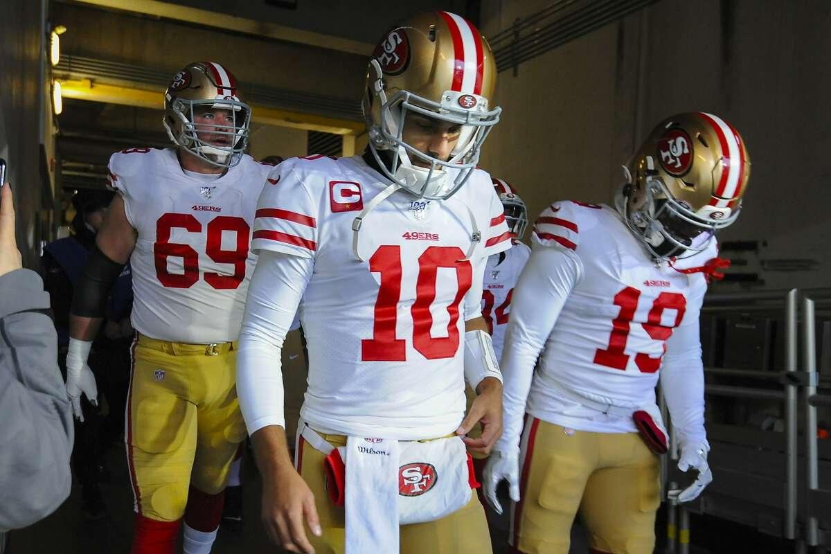 From l-r, San Francisco 49ers offensive tackle Mike McGlinchey (69), quarterback Jimmy Garoppolo (10) and wide receiver Deebo Samuel (19) take the field in the first half of an NFL football game against the Baltimore Ravens, Sunday, Dec. 1, 2019, in Baltimore, Md. (AP Photo/Gail Burton)