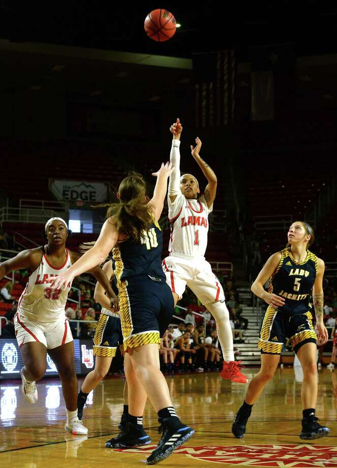 Lamar's Jadyn Pimentel puts up a shot over Howard Payne's Delaney Ingram during their game Monday at the Montagne Center. Students and teachers from several BISD elementaries filled the stands to cheer on the Lady Cardinals.  Photo taken Monday, November 11, 2019 Kim Brent/The Enterprise Photo: Kim Brent / Kim Brent/The Enterprise / BEN