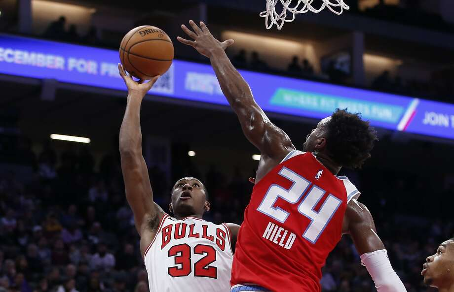 Bulls guard Kris Dunn goes to the basket against Kings guard Buddy Hield at Golden 1 Center in Sacramento. Photo: Rich Pedroncelli / Associated Press