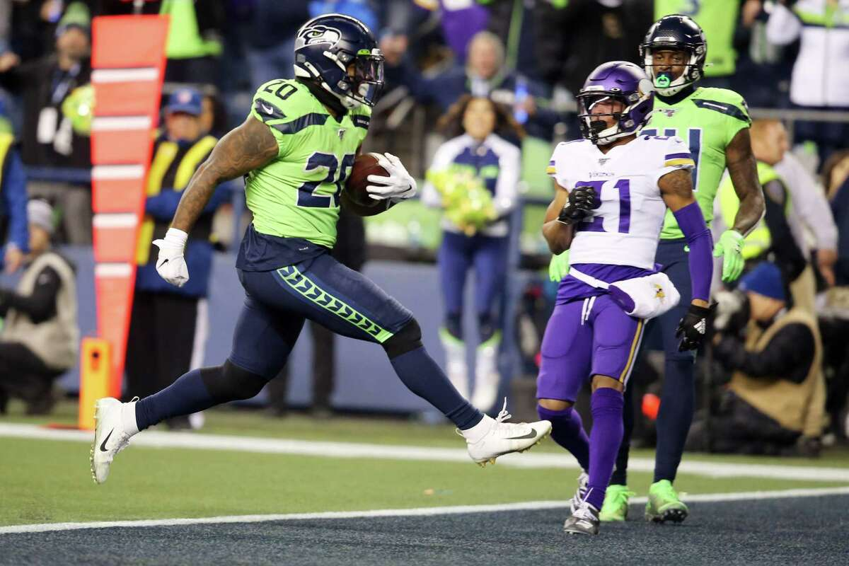 Seattle Seahawks running back Rashaad Penny (20) scores a touchdown during the fourth quarter of Seattle's game against Minnesota, Monday, Dec. 2, 2019 at CenturyLink Field.