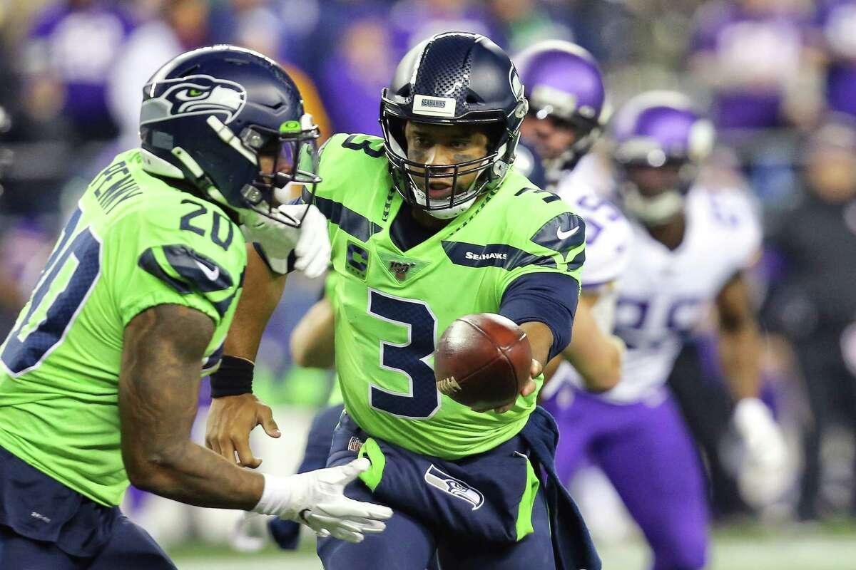 Seattle Seahawks quarterback Russell Wilson (3) hands off the ball to Rashad Penny in the fourth quarter of Seattle's game against Minnesota, Monday, Dec. 2, 2019 at CenturyLink Field.