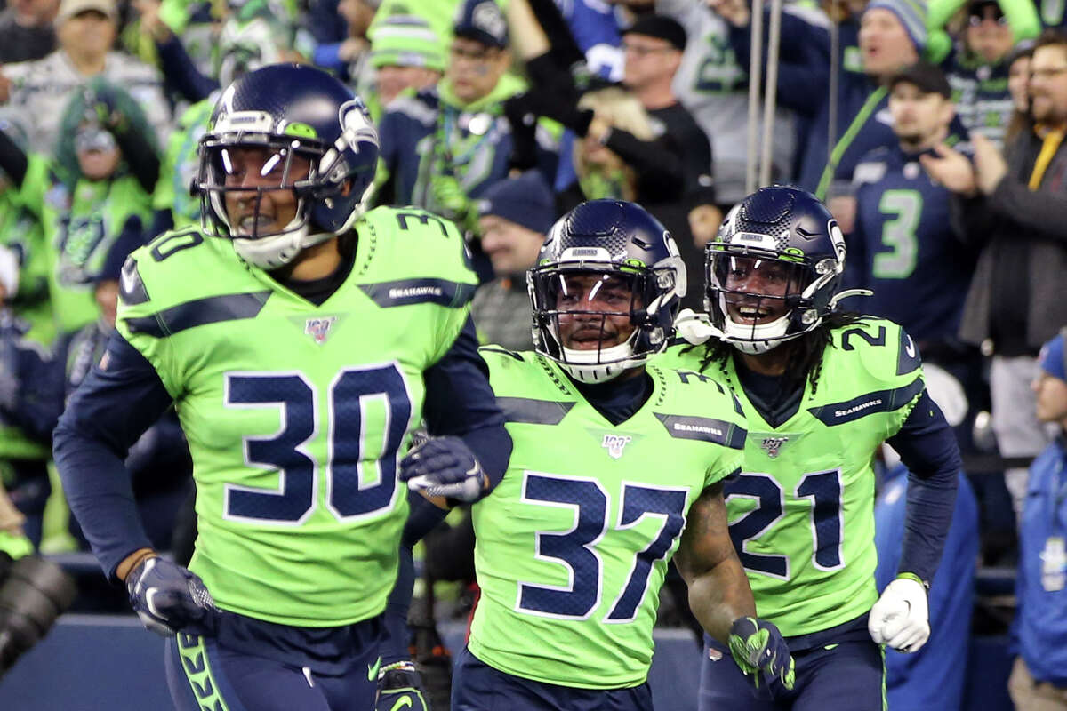 Seattle Seahawks strong safety Bradley McDougald (30), strong safety Quandre Diggs (37), cornerback Tre Flowers (21) celebrate a Seahawks fumble recovery in the final seconds of their game against the Minnesota Vikings, Monday, Dec. 2, 2019 at CenturyLink Field.