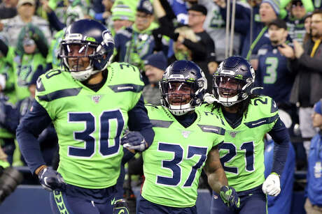 Seattle Seahawks strong safety Bradley McDougald (30), strong safety Quandre Diggs (37), cornerback Tre Flowers (21) celebrate a Seahawks fumble recovery in the final seconds of their game against the Minnesota Vikings, Monday, Dec. 2, 2019 at CenturyLink Field. Photo: Genna Martin, Seattlepi.com / GENNA MARTIN