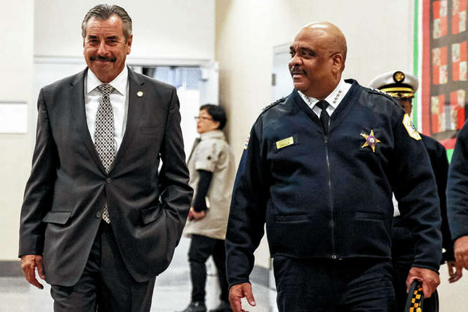 "Chicago's interim Police Superintendent Charlie Beck (left) walks through CPD headquarters on Nov. 8 with retiring Police Superintendent Eddie Johnson, in Chicago. Chicago Mayor Lori Lightfoot fired Johnson on Monday, saying her decision was based his ""ethical lapses."" Beck was to take over the superintendent's job immediately. Photo: Ashlee Rezin Garcia 