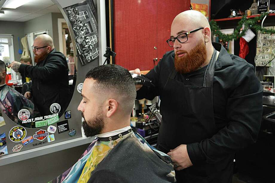 Joey Pelkey, 26, owner of Get Fresh Barber Shop at 131 Saybrook Road in Middletown, was our Person of the Year for 2018. Photo: Cassandra Day / Hearst Connecticut Media