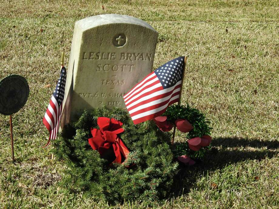 This military veteran's grave was marked with a wreath last year at Fairview Cemetery in League City through Wreaths Across America. This year, National Wreaths Across America Day will be celebrated at 11 a.m. Dec. 14 at the cemetery, 901 N. Kansas. Photo: Courtesy Wreaths Across America
