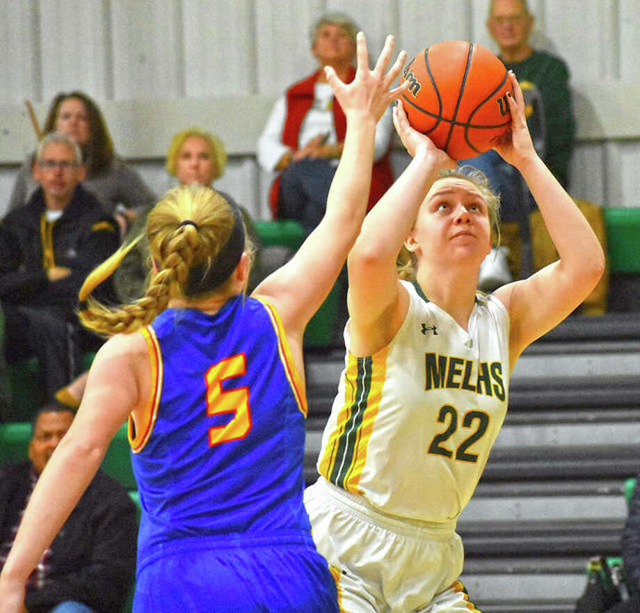 Metro-East Lutheran's Jennifer Leitner puts up a shot in the second quarter over Roxana's Lexi Ryan on Monday in Edwardsville. Photo: Matt Kamp|The Intelligencer