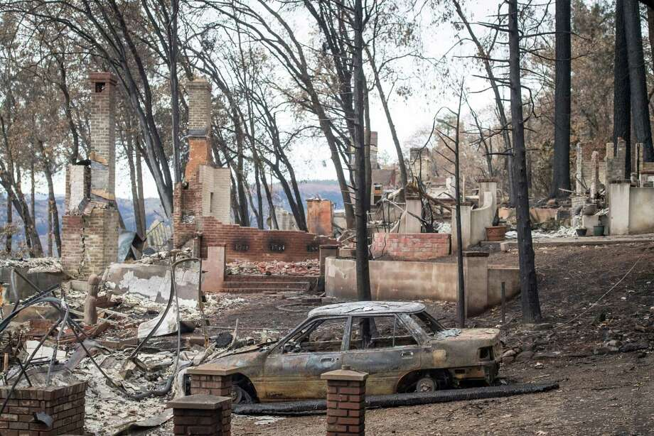 Burned-out homes and vehicles stand in Paradise, Calif., on Nov. 26, 2018.