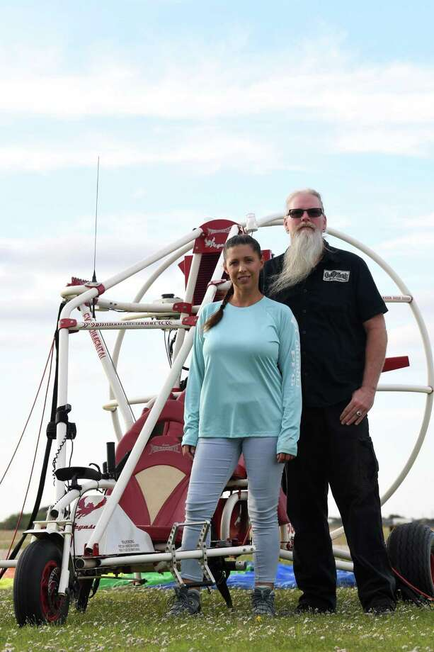 Jenifer and Steve Cole stand by Steve's ppc powered parachute at the Beaumont Municipal Airport on Thursday. Hobby pilots, Steve flies the SmartCar-sized aircraft and Jenifer is a paraglider where she flies with a parachute and backpack like motor and propeller. Photo taken Thursday, 10/24/19 Photo: Guiseppe Barranco/The Enterprise, Photo Editor / Guiseppe Barranco ©
