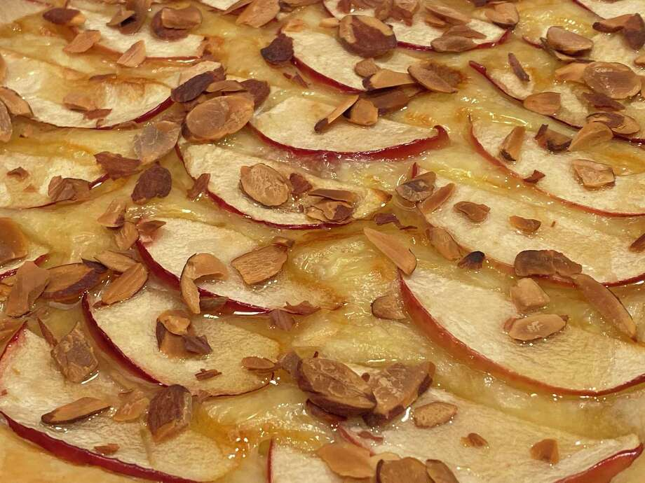 Brie and apple tarts add a nice splash of flavor at any gathering. Photo: TinaMarie Craven/ Hearst Connecticut Connecticut