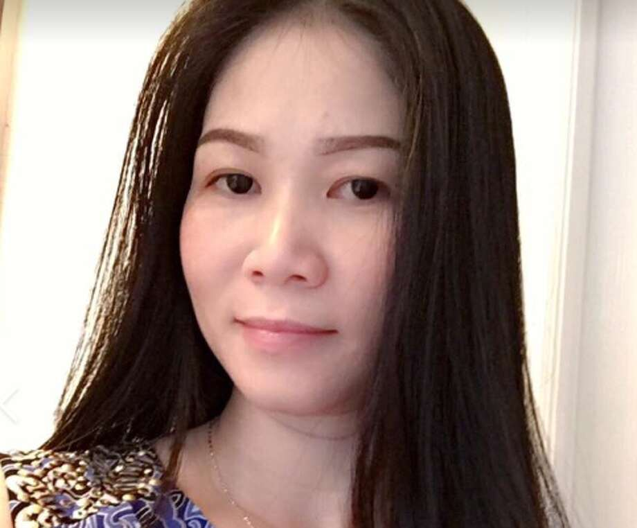 A $15,000 reward is being offered for information on the death of Lieu Julie Nguyen, 38. Two years ago, Nguyen was found shot in a car in Fort Bend County. Photo: Fort Bend County Sheriff's Office