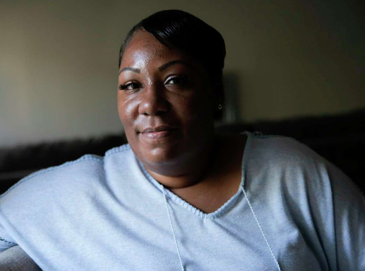 Lovinah Igbani sits in her Houston home on Sunday, Nov. 24, 2019. Igbani stayed in a shelter after leaving an abusive relationship. Currently, there's a lack of resources and funding causing thousands of victims of domestic violence to be turned away from emergency shelters this year in the Houston region.
