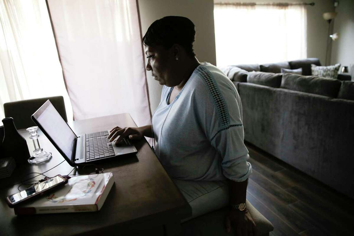 Lovinah Igbani works on her classwork in her Houston home on Sunday, Nov. 24, 2019. Igbani stayed in a shelter after leaving an abusive relationship. Currently, there's a lack of resources and funding causing thousands of victims of domestic violence to be turned away from emergency shelters this year in the Houston region.