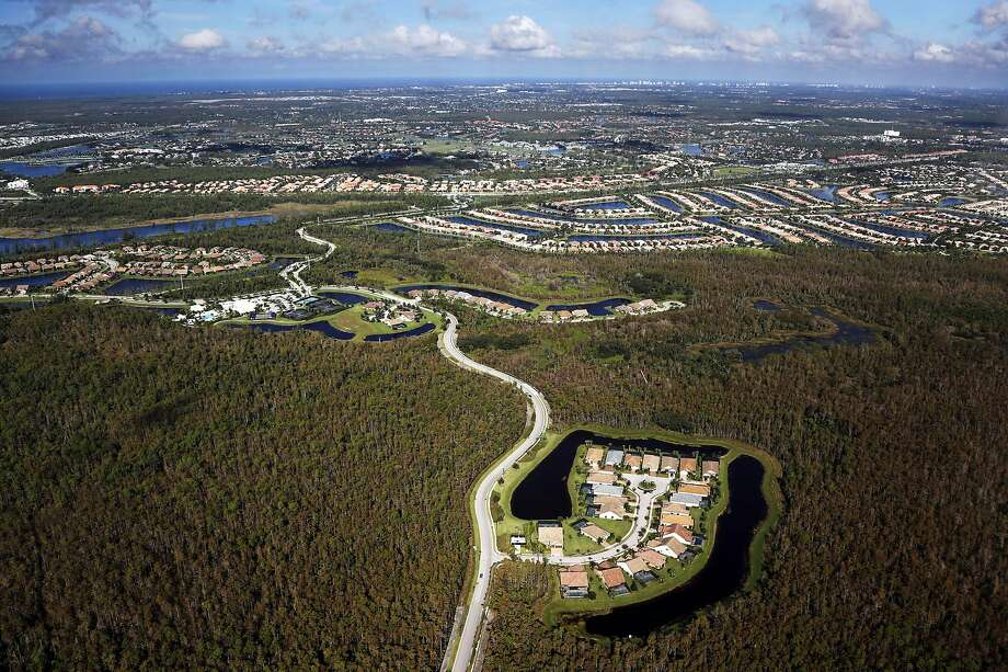 A housing development built in the Everglades wetlands is seen from the air near Naples, Fla. About half of the area's original footprint has been plowed under or paved over. Photo: Associated Press