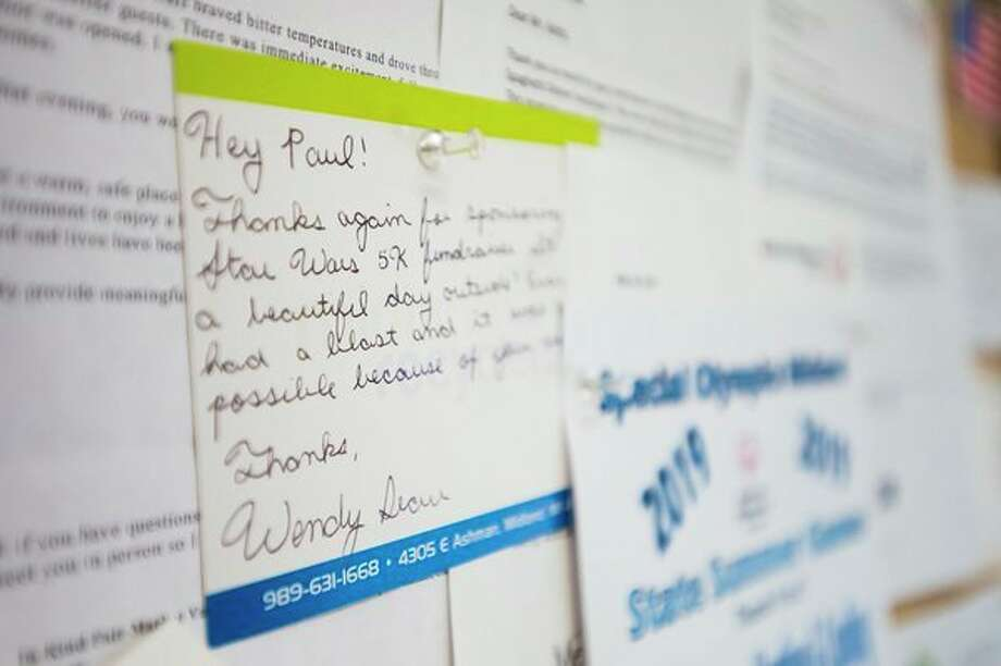 A thank you note hangs on a corkboard inside All Seasons Heating, Cooling and Insulation Tuesday, Nov. 26 at 1819 E. Airport Road in Midland. (Katy Kildee/kkildee@mdn.net)