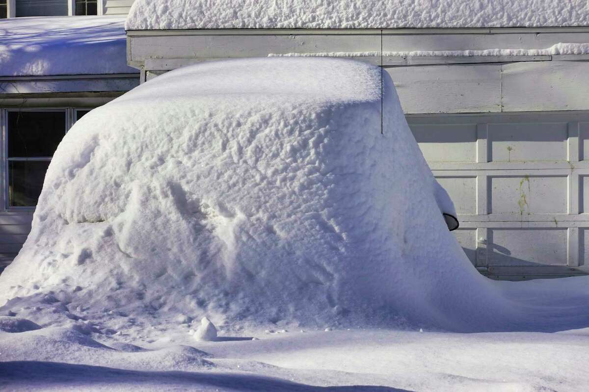 A car parked in the driveway of home is buried in snow, seen here on Tuesday, Dec. 3, 2019, in Schenectady, N.Y. (Paul Buckowski/Times Union)