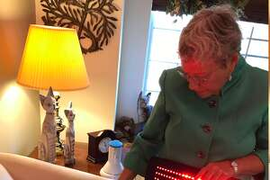 """Cindy      Perlin, author of the book """"The Truth About Chronic Pain Treatments,""""      displays a low-level LED light pain therapy device (Paul Grondahl /      Times Union)"""