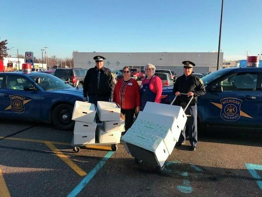 Michigan State Police Tri-City Post partnered with Kroger to distribute 40 complete Thanksgiving meal kits to area families.(Photo provided)