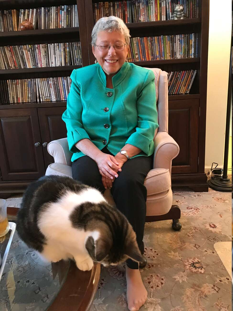 Cindy Perlin with one of her three cats, who are both companion animals and test subjects with various pain treatment devices (Paul Grondahl / Times Union)