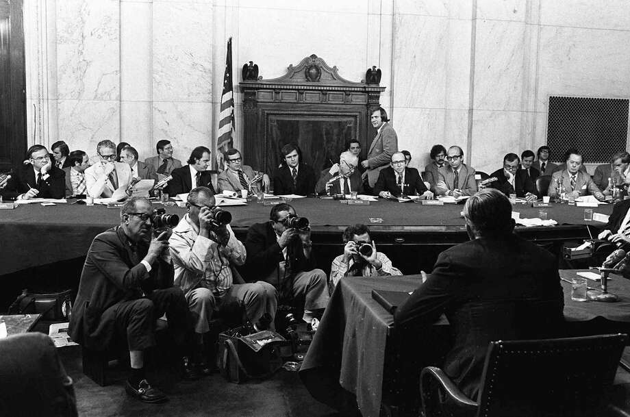 "FILE - In this Aug. 3, 1973, file photo, the Senate Watergate Committee hearings continueon Capitol Hill in Washington.. From left are: Sen. Lowell P. Weicker, Jr; Sen. Edward J. Gurney, Fred Thompson, Sen. Howard H. Baker, Jr; Rufus Edmisten, Sen. Sam Ervin; Sam Dash, Sen. Joseph M. Montoya, Sen. Daniel K. Inouye was absent. Testifying is Lt. Gen. Vernon Walters. In 1973, millions of Americans tuned in to what Variety called ""the hottest daytime soap opera"" _ the Senate Watergate hearings that eventually led to President Richard Nixon's resignation. For multiple reasons, notably a transformed media landscape, there's unlikely to be a similar communal experience when the House impeachment inquiry targeting Donald Trump goes on national television starting Wednesday (AP Photo/File) Photo: Associated Press / AP1973"