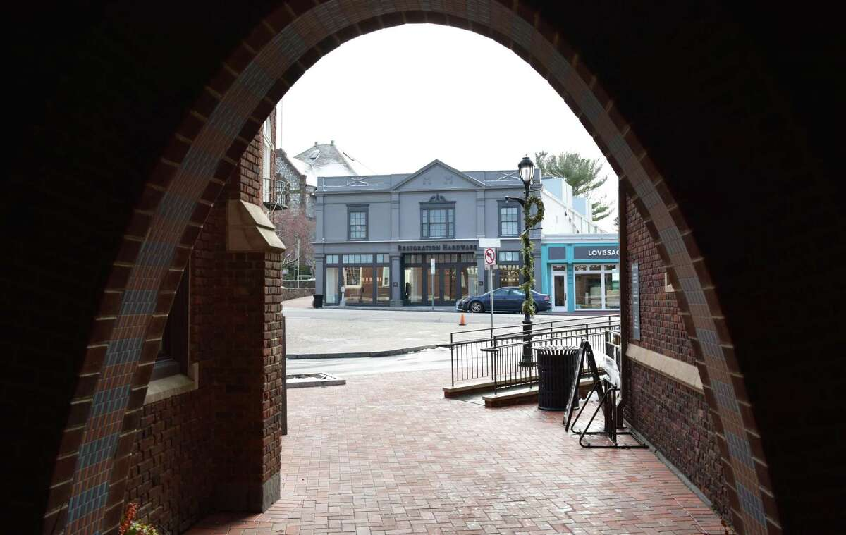The Restoration Hardware building at 76 Post Road E. in Westport, Conn., viewed in December 2019 from the vantage of an archway at Bedford Square.