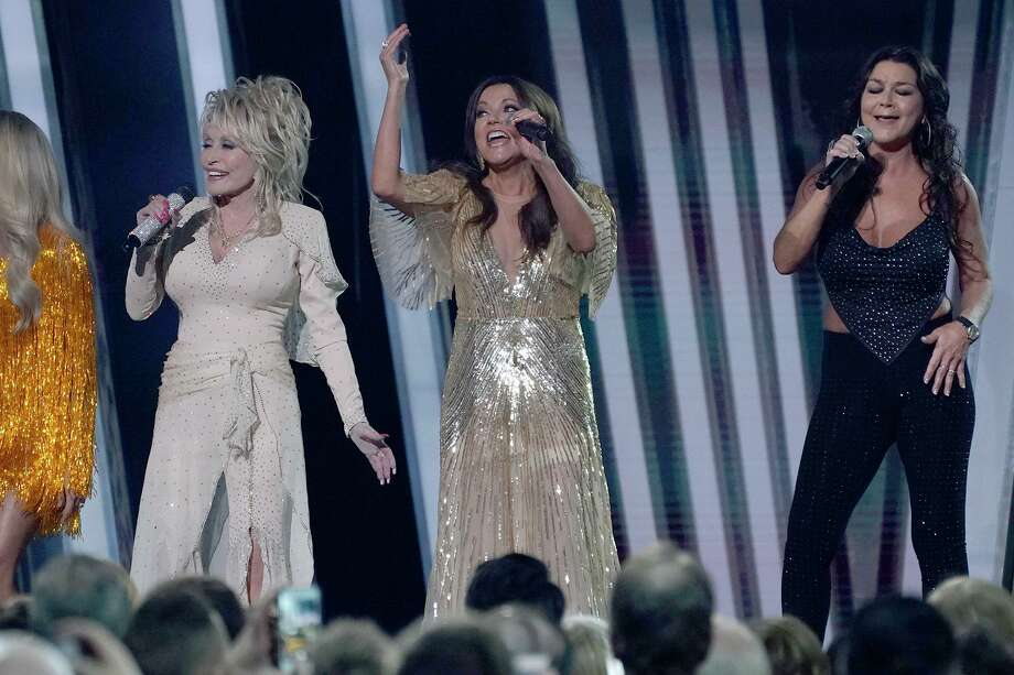 Martina McBride, center, performs with Dolly Parton, left, and Gretchen Wilson at the CMA Awards. Photo: Mickey Bernal / Wireimage /Getty Images / 2019 Mickey Bernal