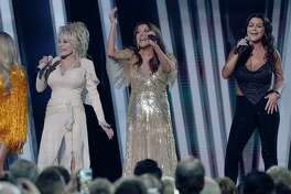 Martina McBride, center, performs with Dolly Parton, left, and Gretchen Wilson at the CMA Awards.