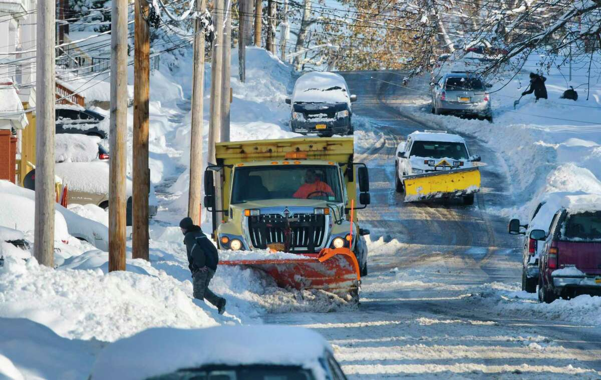 A snow plow clears snow off of Division Street, on Tuesday, Dec. 3, 2019, in Schenectady, N.Y. (Paul Buckowski/Times Union)
