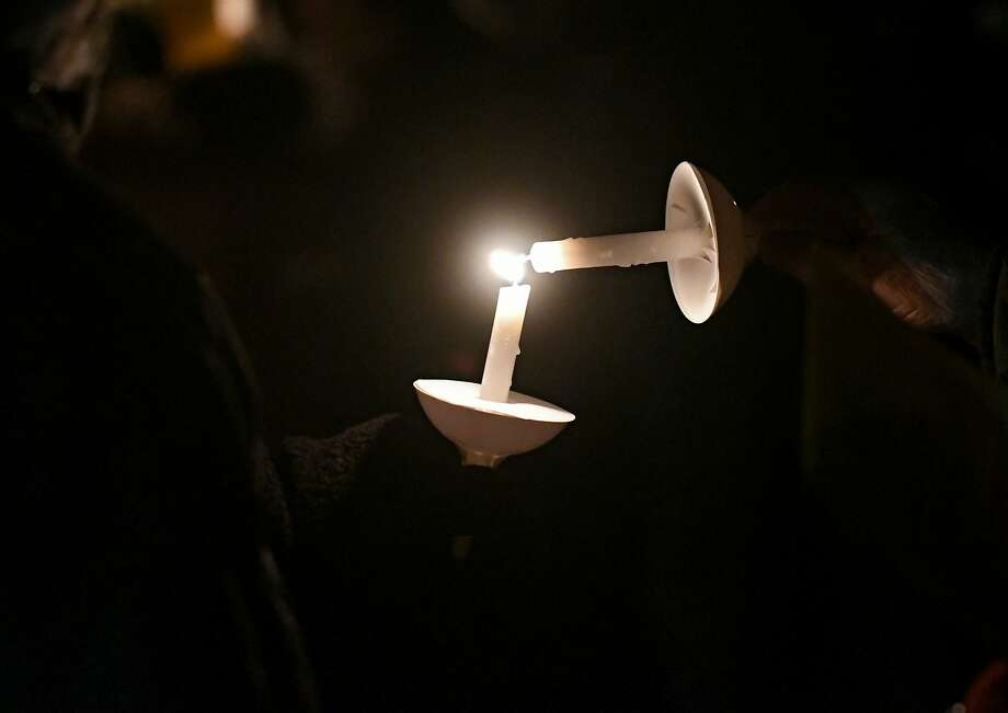 People participate in the first of four candlelight peace vigils held in the Outdoor Chapel at the First United Methodist Church  on Monday, Nov. 28, 2016 in East Greenbush, N.Y. The vigils will be held each Monday of Advent, starting at 6 p.m. and will last for approximately 20 minutes. (Lori Van Buren / Times Union) Photo: Lori Van Buren, Albany Times Union