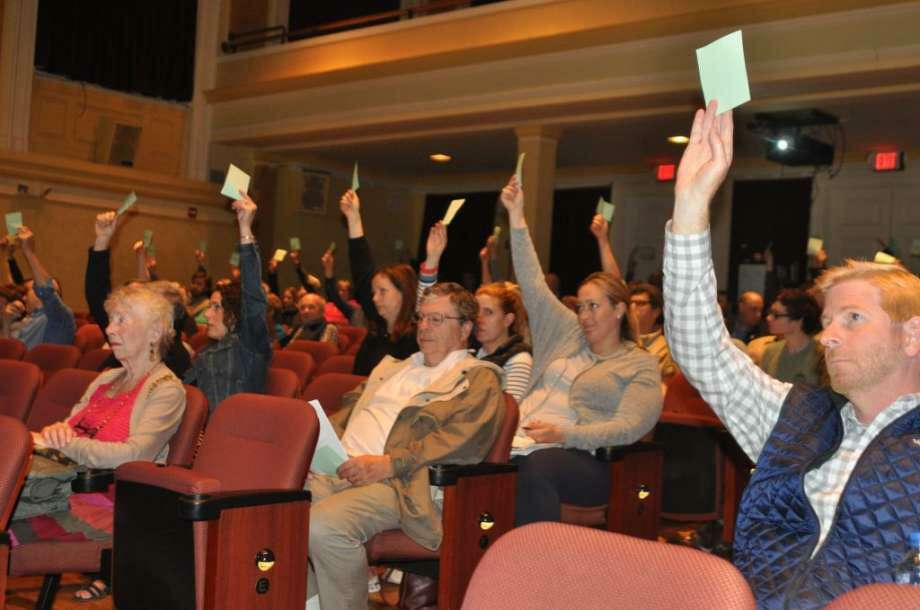 Ridgefield voters cast votes against budget critic Ed Tyrrell's motion to cut the school budget at the Ridgefield Playhouse Monday, May 6. Photo: Macklin Reid / Hearst