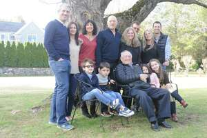 Henry 'Hesh' Eisen, was surrounded by family in front of a huge tree outside The West Lane Inn, where he and family members shared his story. Back row, from left, are: His grandson Eric Eisen and wife Lisa, of Westport; daughter-in-law Linda and son Mel Eisen of Danbury; Henry Eisen, 93-year-old Bar Mitzvah candidate; son-in-law Peter Riggs and daughter Sharon Eisen, of Brookfield; granddaughter-in-law Amanda and grandson Greg Eisen of Ridgefield; and in front great-grandchildren Joshua, Andrew, Alexa and Julia Eisen. Joshua and Julia are Ridgefielders, and Alexa and Andrew are from Westport.