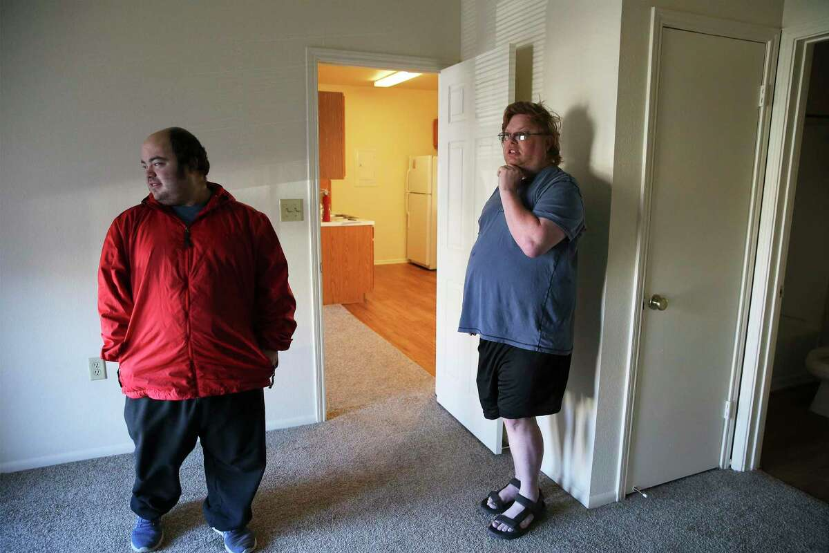 Gary Petersen (right) and his husband, Michael, walk through their new apartment in Boerne, where they eventually moved after they got an eviction notice at their San Antonio rental. The Petersens had paid their rent on time in San Antonio, but were threatened with eviction after filing multiple complaints.
