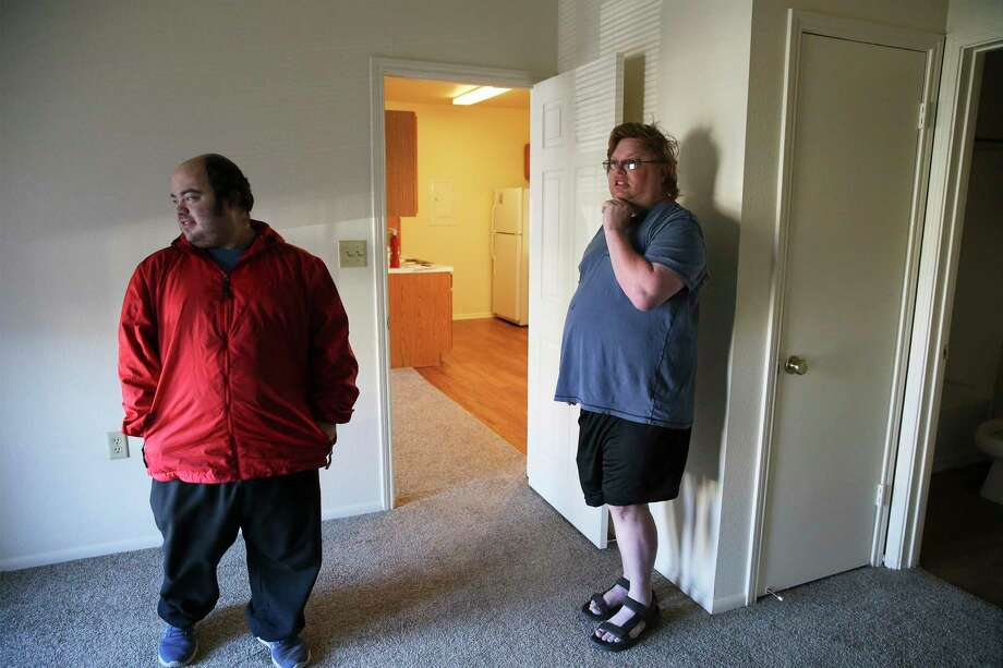 Gary Petersen (right) and his husband, Michael, walk through their new apartment in Boerne, where they eventually moved after they got an eviction notice at their San Antonio rental. The Petersens had paid their rent on time in San Antonio, but were threatened with eviction after filing multiple complaints. Photo: Kin Man Hui / ©2019 San Antonio Express-News