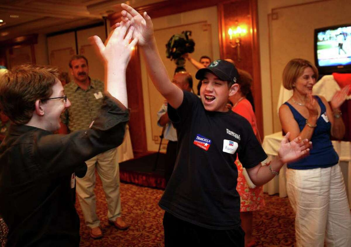 Ted Lopatin, 18, left of Greenwich, and Aaron Gaberman, 15 of Weston, supporters of Republican candidate Dan Debicella, high five as they listen to the primary election returns for the fourth congresional district. Debicella supporters gathered at the Norwalk Inn on Tuesday night, August 10, 2010.