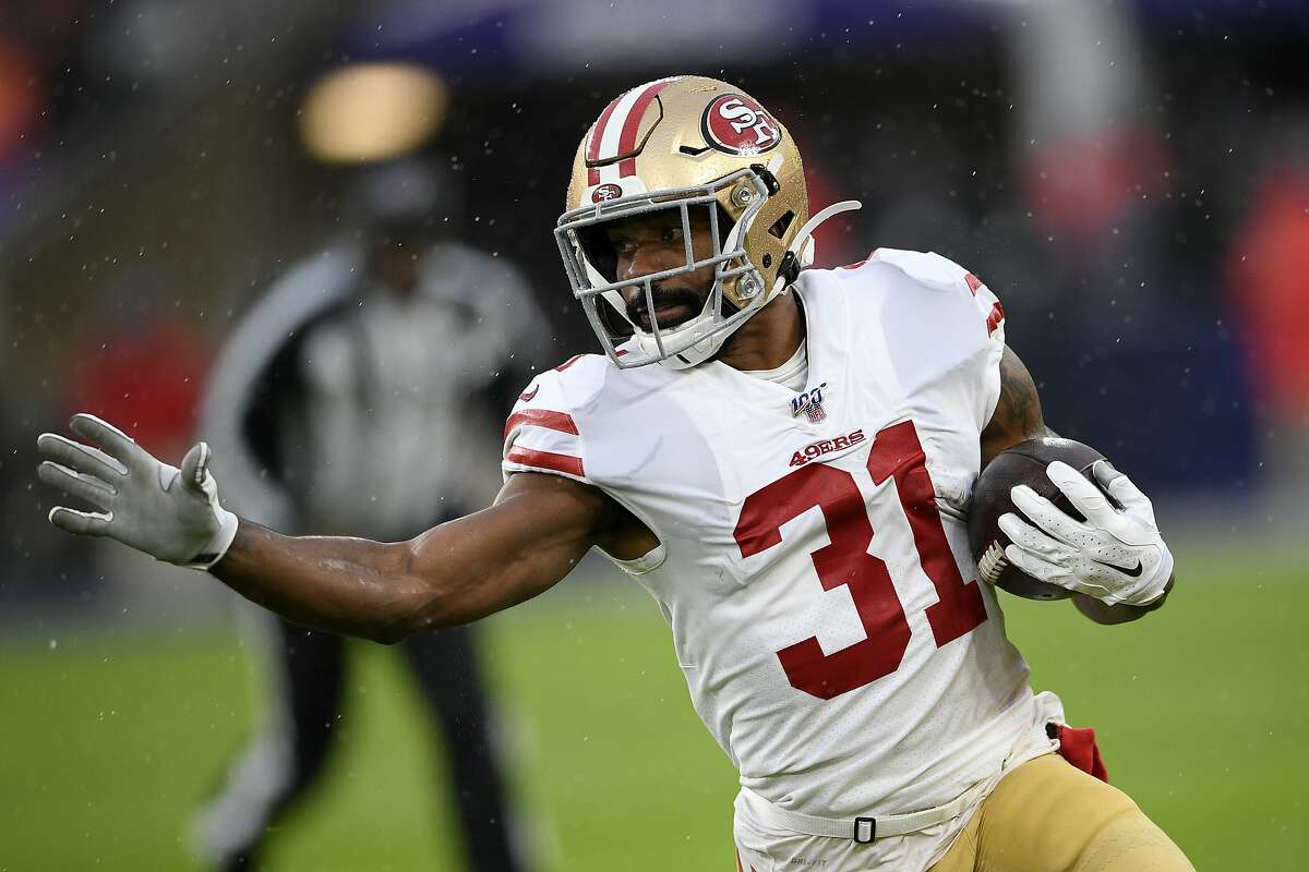 San Francisco 49ers running back Raheem Mostert (31) runs with the ball in the first half of an NFL football game against the Baltimore Ravens, Sunday, Dec. 1, 2019, in Baltimore, Md. (AP Photo/Nick Wass)