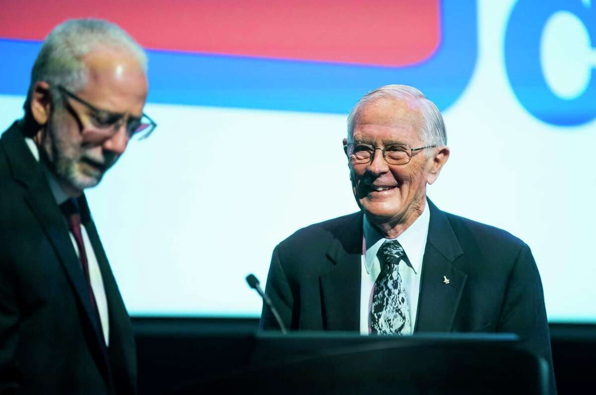 Apollo astronaut Charlie Duke smiles at Johnson Space Center director Mark Geyer while the two spoke during an announcement by the Texas Legislative Conference that Duke will be the organization's