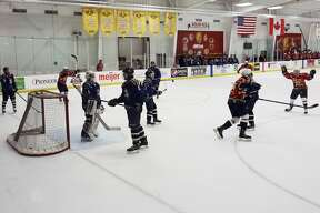 Big Rapids High School's hockey team takes down Cadillac 6-2 during the Cardinals' first home game of the season.