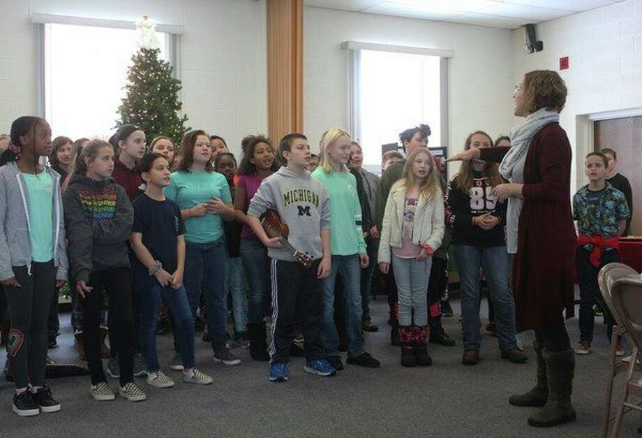 The Big Rapids Middle School Choir performed a variety of Christmas songs during Giving Day at the First United Methodist Church in Big Rapids. Hosted by Women's Information Service Inc., this event brought people from the community together for a day of fun with the goal of raising money to support the organization. (Pioneer photo/Taylor Fussman)