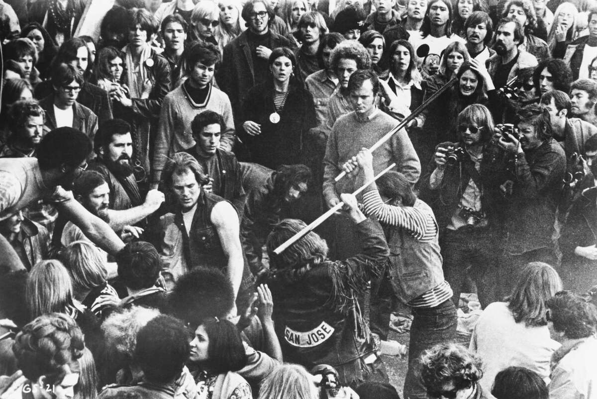 The legendary motorcycle group Hells Angels fights with pool cues during the Altamont Free Concert on Dec. 6, 1969.