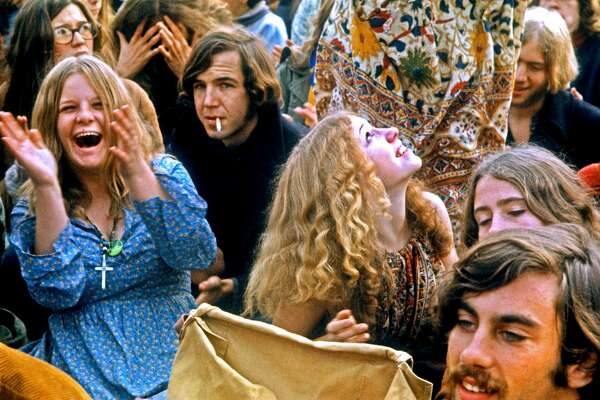 People in the crowd cheer as musical acts perform at the Altamont Free Concert on December 6, 1969.