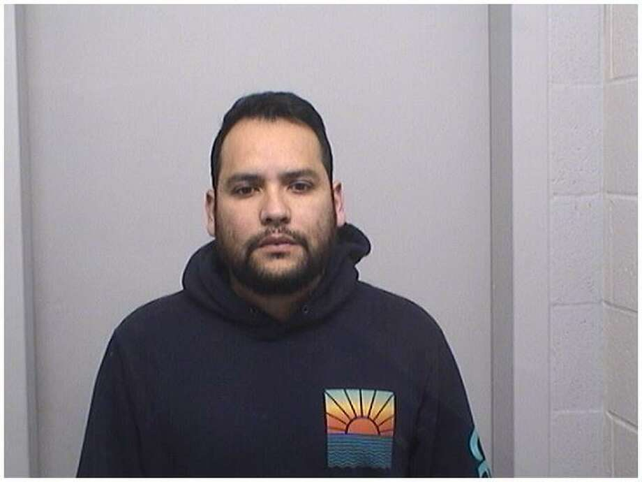 Convicted felon Johan Cifuentes, 32, of Greenwich was charged with stealing an assault weapon and a shotgun out of a car in Stamford. Photo: Stamford Police Department / Contributed