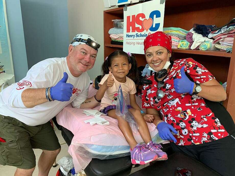 Dr. Robert Arbuckle and Marleney Arbuckle from Wilton get a thumbs up from one of their patients in the Peruvian Amazon on a mission with Healing the Children Northeast. Photo: Christiana Dittmann /Contributed / Wilton Bulletin Contributed