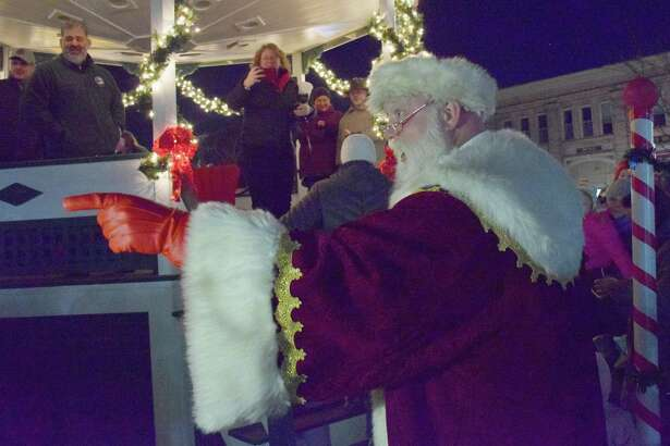 Spectrum/The Greater New Milford Chamber of Commerce held the annual lighting of the trees on the Village Green Nov. 30, 2019. Santa Claus made an appearance and visited with attendees after the trees were lighted. This is the 53rd year the trees have been put up by the Men's Club of the New Milford United Methodist Church and lighted. Above, Santa acknowledges a believer in the crowd of those gathered for the lighting of the trees.