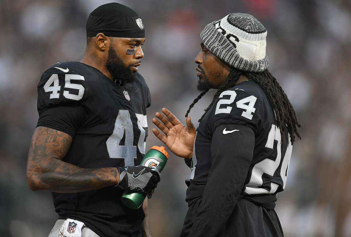 OAKLAND, CA - AUGUST 31: Marshawn Lynch #24 giving advice to running back George Atkinson #45 of the Oakland Raiders during the first quarter against the Seattle Seahawks at Oakland-Alameda County Coliseum on August 31, 2017 in Oakland, California. ~~